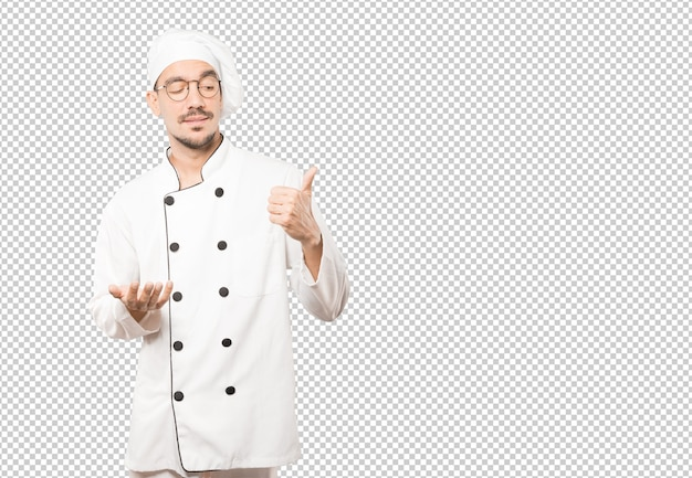 Hesitant young chef gesturing that everything is fine