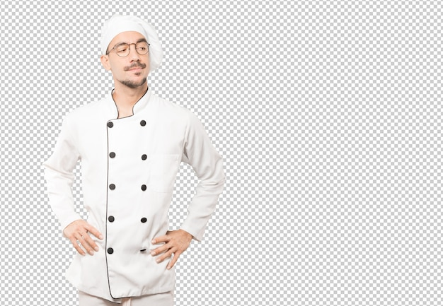 Hesitant young chef looking up gesture