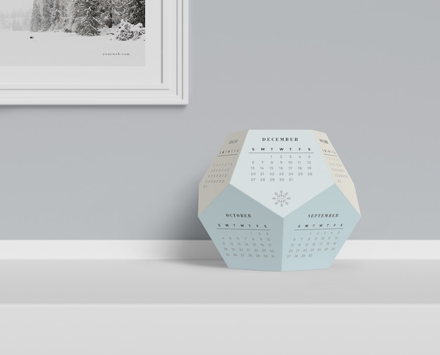 Hexagonal calendar conceput on table