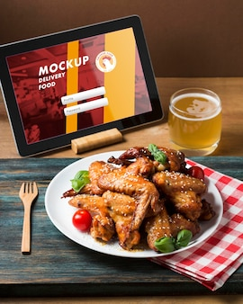 High angle american food and tablet