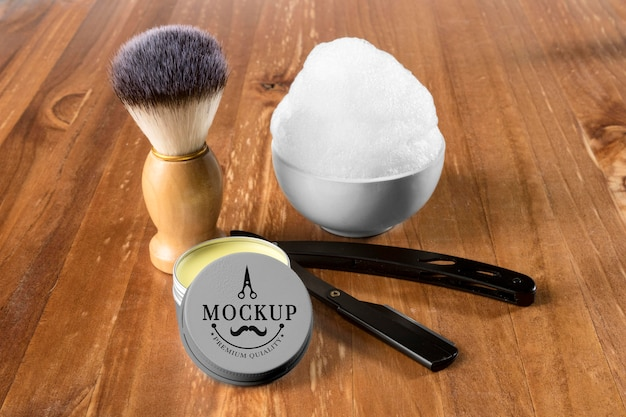 High angle of beard care set with shaving foam and brush