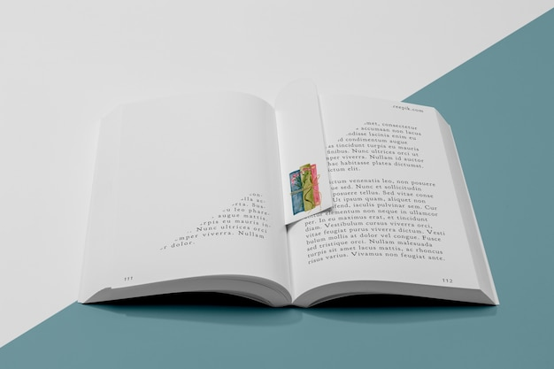 High angle bookmark and open book mock-up
