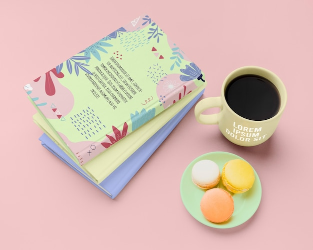 High angle books with macarons and coffee