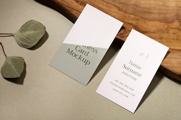 High angle business cards and leaves