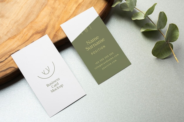 High angle business cards and plant