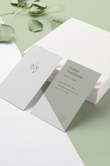 High angle business cards with leaves