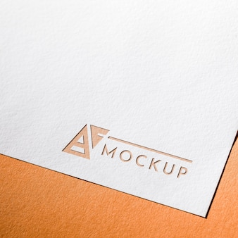 High angle of business mock-up card on coarse paper