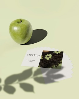 High angle of card with apple and leaves shadow