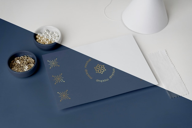 High angle of carnival invitation with beads and cone