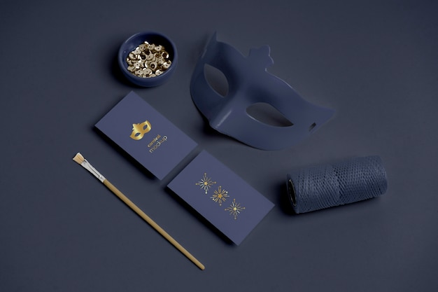 High angle of carnival invitations with mask and beads