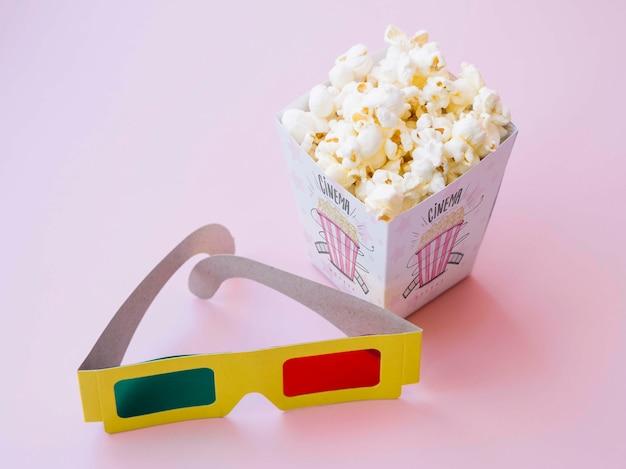 High angle of cinema glasses with popcorn