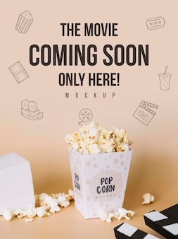 High angle of cinema popcorn with clapperboard