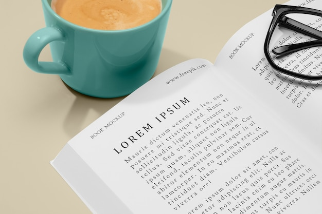 High angle coffee and glasses with open book mock-up
