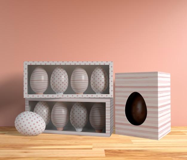 High angle decorative eggs and chocolate egg on table