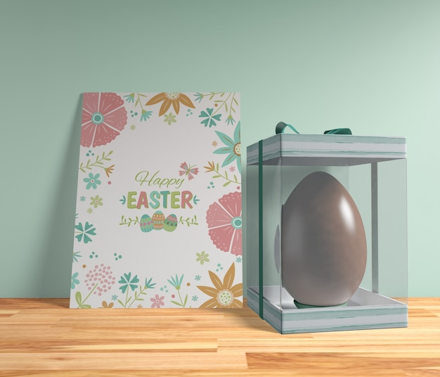 High angle easter egg with card on table