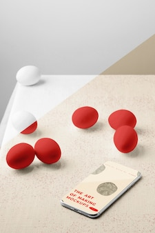 High angle of eggs mock-up with smartphone