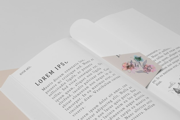 High angle floral bookmark and open book mock-up