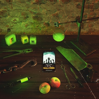 High angle green neon light with smartphone on wooden table