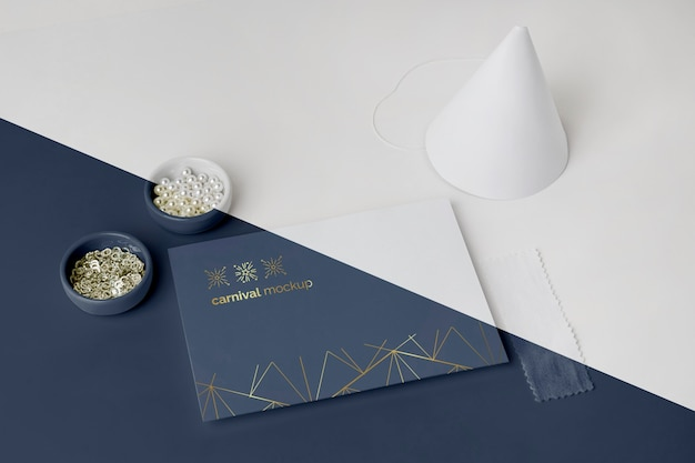 High angle of minimalistic carnival invitation with cone and beads