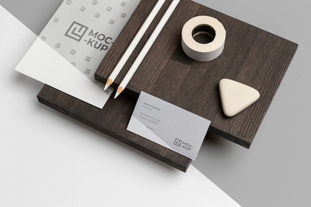 High angle mock-up stationery on wood composition