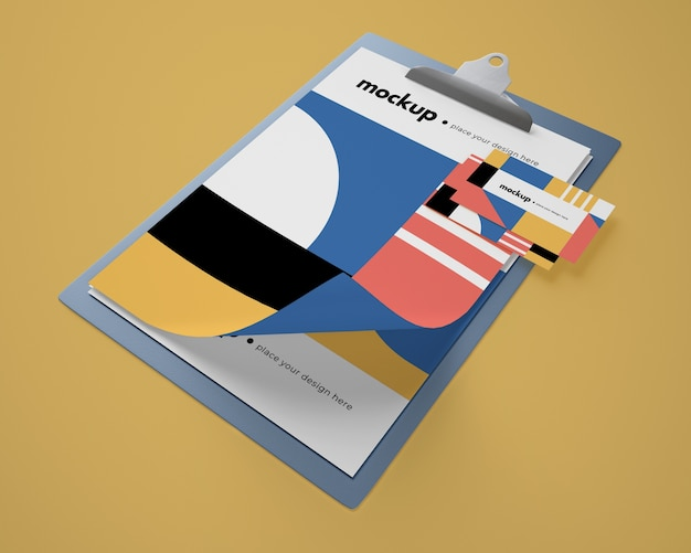 High angle of notepad mock-up with geometric design and card