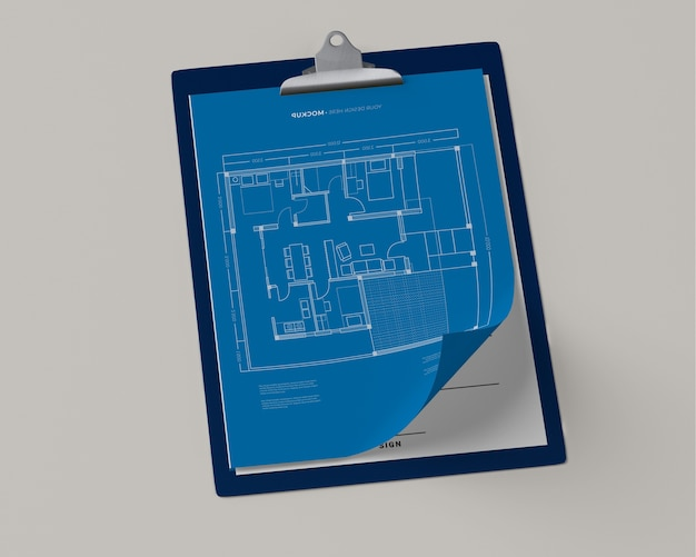 High angle of notepad with blueprint