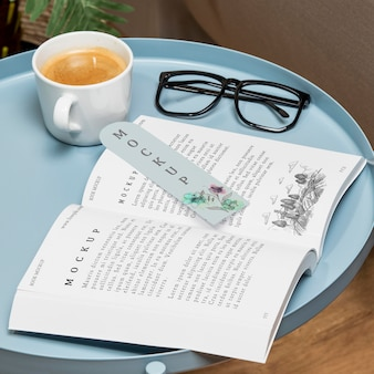 High angle open book mock-up on coffee table with glasses