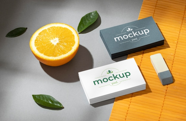 High angle of paper stationery with citrus fruit