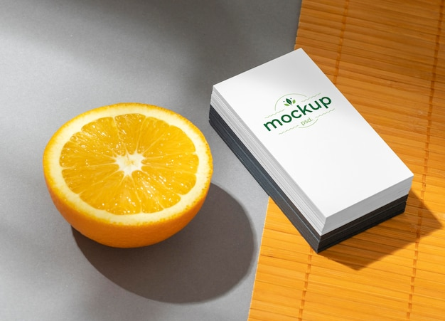 High angle of paper stationery with citrus