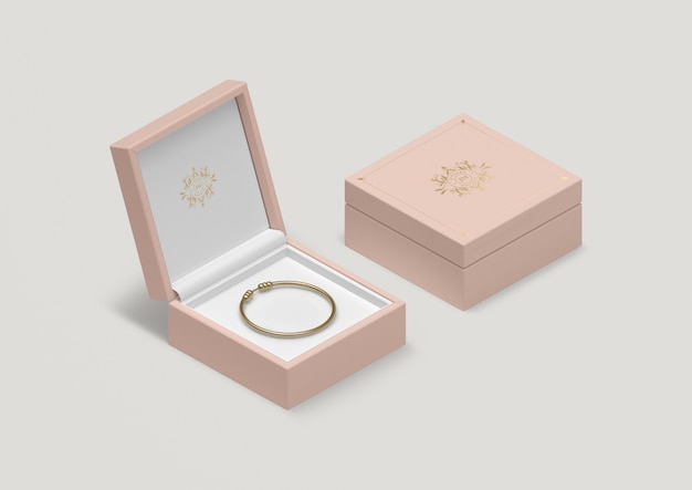 High angle pink jewelry box with golden bracelet