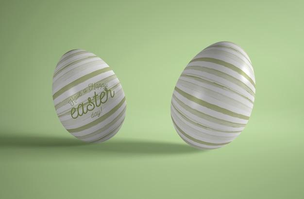 Высокий угол два пасхальные яйца на столе