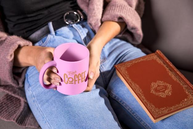 High angle woman holding pink mug