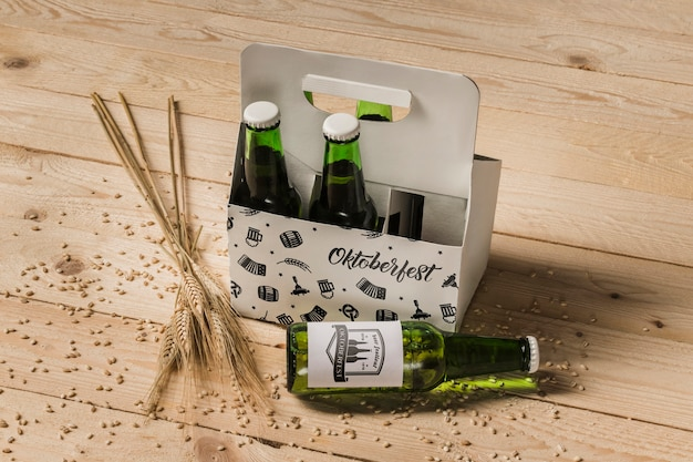 High view beer bottles with wooden background