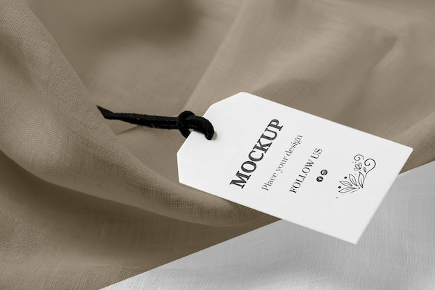 High view mock-up of clothing labels on soft fabric