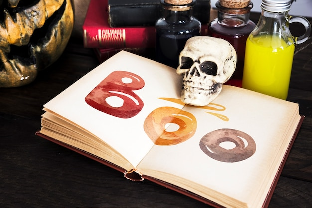 High view of open book and halloween stationery items