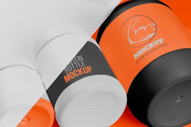 Bottiglia arancione di alta vista di mock-up di proteine in polvere