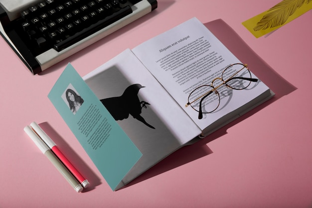High view reading glasses on book and typewriter