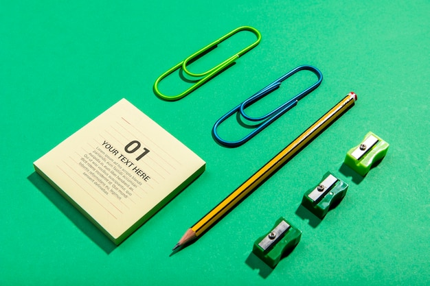 High view sticky-notes and pencil knolling desk concept