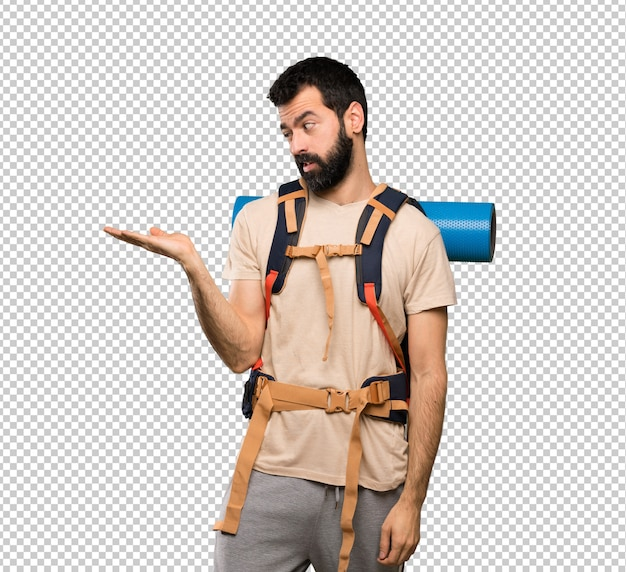 Hiker man holding copyspace with doubts