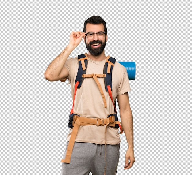 Hiker man with glasses and surprised