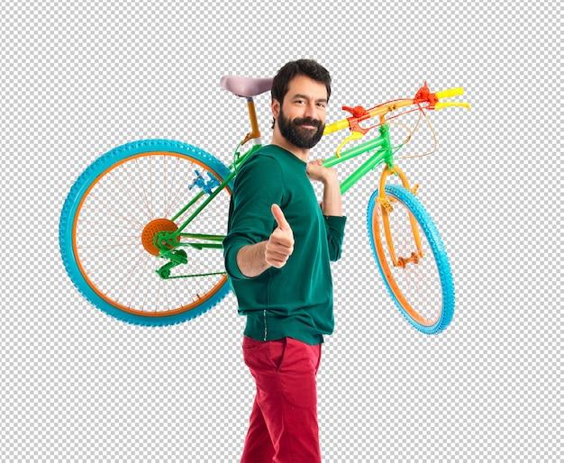 ヒップスター、親指で、自転車に乗る