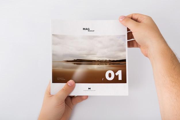 Holding closed square magazine mockup