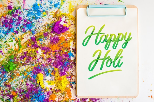 Holi festival mockup with clipboard