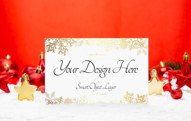 Holiday card and red decorations mockup