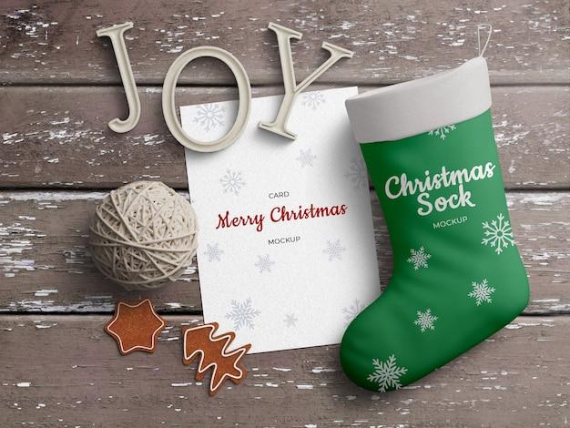 Holiday greeting card and christmas stocking sock mockup