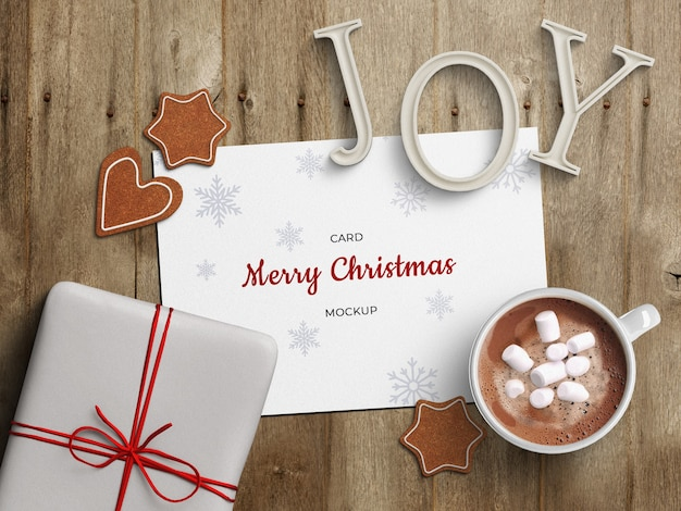 뜨거운 음료와 휴일 인사말 카드 모형