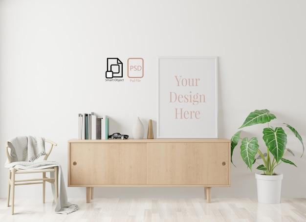 ホームインテリアポスターは、床と白い壁、リビングルームの背景のフレームでモックアップします。 3dレンダリング。