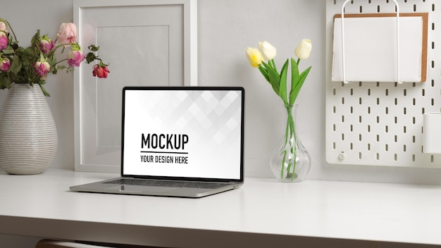 Home office desk with laptop mockup and flower vase