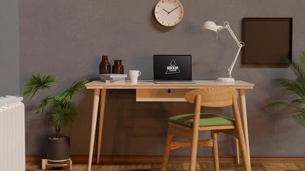 책상에 노트북 및 소모품이있는 가정 작업 공간 인테리어 디자인