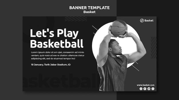 男性のバスケットボール選手と黒と白の水平バナーテンプレート